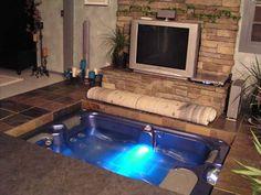 Hidden hot tub in living room floor...yes, please!
