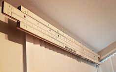 Giant quirky slide rule as a valance by Fresh Pineapple Interiors