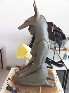 a female wearing a mask of Anubis- this is beautiful Wayne