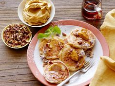 The beauty of silver dollar pancakes is that you get lots of crispy edges in every bite. Bobby Flay dresses his up by mixing pecans into the batter and serving bourbon-molasses butter on the side.