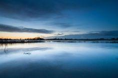 Sun ries slowly over the flooded floodplains alongside the river Merwede near the city of Gorinchem.