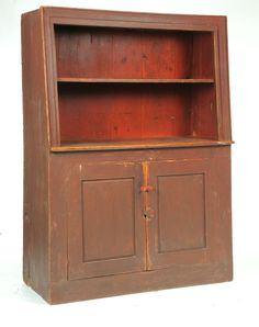 Sold for $5,100 CANT-BACK CUPBOARD. American, early 19th century, pine. One-piece with an open top and two raised-panel doors in the lower section