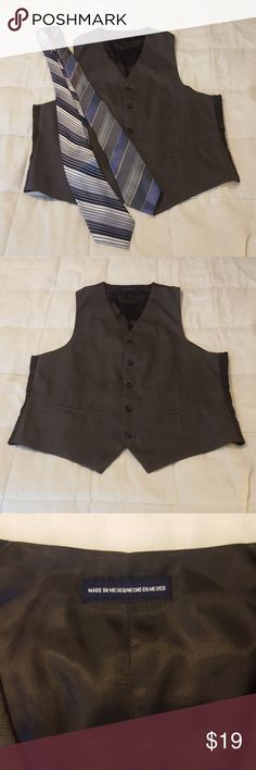 Mens 5 Button Vest Stafford Performance Classic Mens 5 Button Vest Stafford Performance Classic Fit. This vest can be dressed up or down. Wear with dress slacks for a professional look or with jeans &  a t shirt for a casual look. Excellent used condition.  Charcoal Plaid pattern. Stafford Performance Suits & Blazers Vests