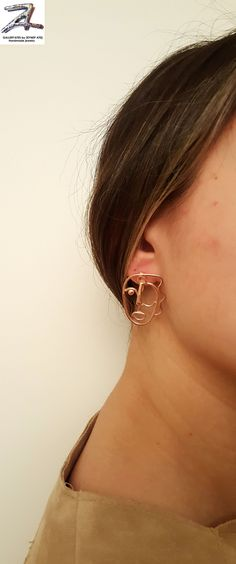 a4fb8107abc2 These statement face earrings are wearable pieces of art.
