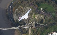 On 10 April 2003, Air France and British Airways simultaneously announced that they would retire Concorde later that year. Their reasons were low passenger numbers after the Paris crash, the slump in air travel after 9/11, and rising maintenance costs. Here: Concorde flies over Clifton Suspension Bridge in Bristol in 2004, on its final flight. It returned to its birthplace in Filton, where it has remained.