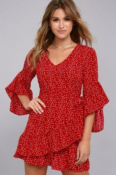 Be 100% on-trend in the Whole Heart Red Polka Dot Wrap Dress! Red white polka dot woven poly shapes a V-neckline, and ruffled flounce sleeves. Darted bodice and tying waist with a ruffled wrap skirt.