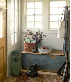 The antique trunk in this quaint Connecticut cottage provides convenient and much needed storage inside the front door, while adding to the rustic atmosphere of the home.   - CountryLiving.com