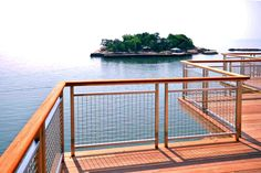 Banker Wire's simple and elegant L-62 stainless steel wire mesh was used on this deck's railing infill panels. The stainless and cedar together blend nicely against the Atlantic background. Banker's highly defined lockcrimp wire mesh is not duplicated anywhere in the wire cloth industry. It is among the most versatile and budget friendly architectural wire mesh crimp styles and is often the material of choice for wire mesh infill panels.