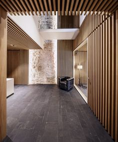 Stone walls wood, organic, traditional and natural stone. Arquia Banca Office in Girona Spain Javier de las Heras Solé architects Architecture Design Concept, Contemporary Architecture, Architecture Details, Interior Architecture, Ceiling Design, Wall Design, House Design, Modern Interior, Interior And Exterior