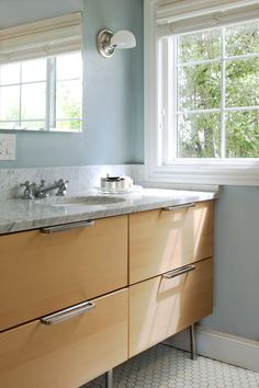 Web Image Gallery note the marble countertop and single sink on top of an ikea godmorgon vanity Transitional