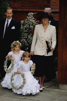 Sarah, Duchess of York with little bridesmaids Beatrice and Eugenie.