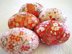 Red and Pink Cherry Blossom Origami Decoupage Easter Eggs--Set of 5 wood eggs decoupaged with beautiful pink, white, and red cherry blossom floral Japanese yuzen chiyogami papers. Finished with water-based sealant and acrylic. Labor intensive work of love, each paper piece is cut into strips while leaving the paper whole, and then glued and shaped to the egg for a perfect fit.