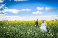 A fun saunter through the Spring rapeseed oil field! Love vibrant the yellow and blue :) At Mythe Barn wedding venue - England