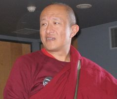 What Makes You a Buddhist? by Dzongsar Jamyang Khyentse Rinpoche Once, I was seated on a plane in the middle seat of the middle row on a trans-Atlantic flight, and the sympathetic man sitting next … Buddhist Teachings, Buddhist Quotes, Maroon Skirt, Man Sitting, Shaved Head, Tibetan Buddhism, Quote Of The Day, The Row, Buddha
