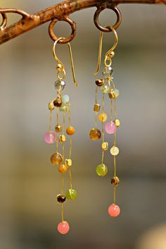 These elegant Fair Trade Akha Reena Celebration Earrings come to us from high in the mountains of northern Thailand. The artisan truly captures the colors of a spring festival with these elegant handm Cute Jewelry, Jewelry Shop, Jewelry Crafts, Jewelry Design, Women Jewelry, Handmade Wire Jewelry, Earrings Handmade, Handmade Accessories, Crystal Jewelry