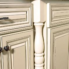 Cream cabinets with grey glaze and island in grey