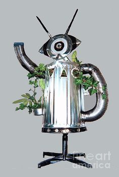 'ROBOCAN' by Bill T.  A fine recycling art project and reuse of the metal garbage can. Throw in metal dryer hoses, a pair of wood spindle antenna, an oversize glass eye, organic matter and voila, you have the coolest ROBOCAN planter around! Design Idea by Bill T. Card and Print image available from the artist.
