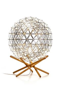 """Inspired by the principle of """"tensegrity"""" (tensional integrity; floating compression), Raimond Tensegrity embodies a perfect balance between push and pull forces. A giant floor lampLED sphere appears to hover above its aerial wood stand with ethereal grace. It was a dream of its desi #Concept #Floorlamp #Handmadelighting #Lamp #Led #Lighting #Lightingdesign #Metallic #Woodlamp #Woodworking"""