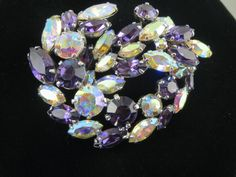 SHERMAN Amethyst & Aurora Borealis Brooch by MiSELLaneousTreasure on Etsy https://www.etsy.com/listing/239781338/sherman-amethyst-aurora-borealis-brooch