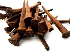 Rusty iron (iron oxide). Used as orange/brown pigments since the prehistorical era.