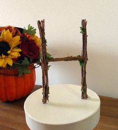 Made out of grapevines!!  perfect for our winery wedding :)