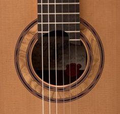 What a rosette by Kris Barnett!    More info here: http://www.guitarbench.com/2010/09/01/kris-barnett-guitars-luthier-interview/