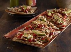 We love the new #flatbread appetizers at Hard Rock Cafe in #Vegas. Try this Southwest Chicken with grilled chicken, pico de gallo, roasted red peppers, green onion, avocado, mozzarella and spicy jalapeno sauce.
