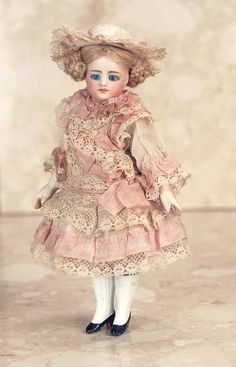 French Mignonette   —  6'' All-Bisque  Doll  in Wearing Superb Antique Rose Silk and Lace Dress with Undergarments and Matching Bonnet,  c.1885 (462×720)