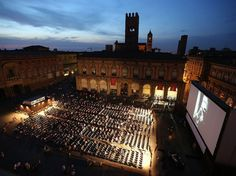 """When the weather warms, Cineteca di Bologna turns the city's Piazza Maggiore into one of the most historic outdoor movie venues, with Renaissance architecture surrounding the plaza on all sides and the dome of the Sanctuary of Santa Maria della Vita rising behind the screen. Cineteca di Bologna holds 51 screenings under the stars throughout the summer, with eight nights dedicated to the """"Il Cinema Ritrovato"""" (Cinema Rediscovered) series of classic movies. It also claims that the Piazza ..."""