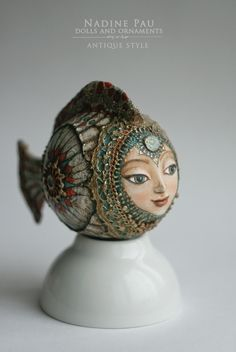 "by Nadine Pau. Christmas ornaments. ""White Fish""  Papier mache, oil patina varnish.  Sold  #christmasornaments #nadinepau"