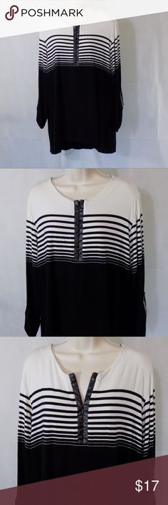 MARIA GABRIELLE Tunic Shirt Knit Top Women Size 3X ITEM DESCRIPTION: Maria Gabrielle Hi-Low Tunic Top with Roll Tab Sleeve  Women Size 3XL  Color: black white  Pattern: Striped Top and solid bottom  Sleeve Length: Quarter length   Closure: pullover ¼ Zip   Fabric: 94% rayon 6% spandex  Made in: China  ITEM CONDITION:  Pre-owned...GREAT USED CONDITION!  ITEM MEASUREMENTS (Laying flat): Chest (Armpit to Armpit): 23.5 in Arm Length: 17 in Back Length: 29 in Maria Gabrielle Tops Tunics