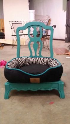 Dog bed that I made from an old chair.