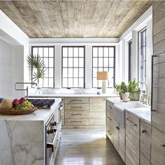 Beautiful marble, glass, natural wood kitchen designed by Jeffrey Dungan. http://www.kristywicks.com