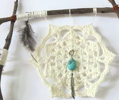 Peace Catcher detail. Feathers, twigs, leather, cotton, turquoise, silver. Crochet forget-me-not flower.
