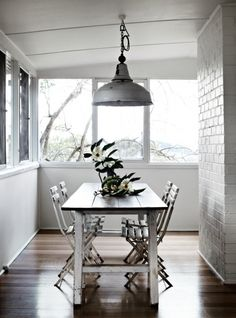 19 dining spaces you would be proud to have in your home: Antique tables and chairs create a private dining space in an otherwise awkward corner of the Orchard Keepers house in Red Hill, Victoria. This home is available to rent.
