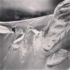 Eero Niemela miller flips a backcountry spine in Canada. Photo: Oli Gagnon  #snowboarding  #canada