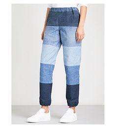 KSENIA SCHNAIDER - Reworked denim track pants | Selfridges.com