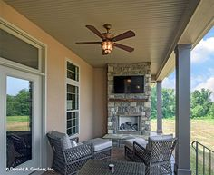 A back porch with fireplace is the perfect place for enjoying crisp fall afternoons. The Foxglove #1297. http://www.dongardner.com/house-plan/1297/the-foxglove. #RearPorch #HomePlan #Fireplace