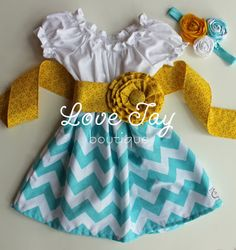 Find a girl's blouse, make a circle skirt and attach the two. Make a wide sash with an attached fabric flower
