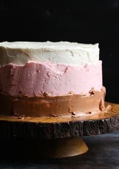 Neapolitan Cake is a three layer, chocolate, strawberry, and vanilla cake covered in silky Swiss Meringue Buttercream and topped with drippy chocolate ganache! Garnished with a few cute ice cream cones and you have a showstopper! #cookiesandcups #dessert #cake #neapolitan #recipe #baking