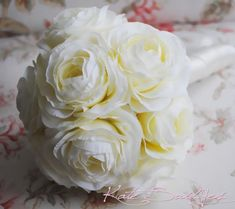 Twelve creamy silk ranunculus make Cream Ranunculus Wedding Bouquet.  Hand-tied with ivory ribbon, excellent bridesmaids bouquet.  The bouquet is approx. 6.5 inches wide and 11 inches tall.