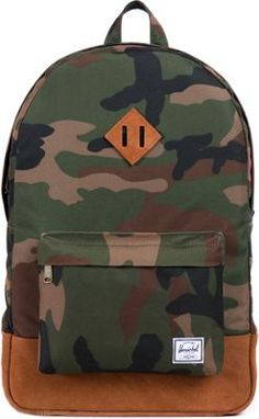 56daae1c9c8 Herschel Supply Co. Heritage Backpack Woodland Camo Hairy Suede One Size.  Fully lined with Herschel supply s signature coated cotton poly fabric.