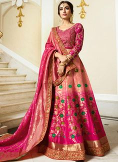 Beautiful pink tones put together over a rich and classy jacquard lehenga choli set! For an Indian wedding or an opulent celebration, you can wear this pink ombre jacquard silk lehenga choli with heavy traditional jewellery. Bollywood Lehenga, Pink Lehenga, Bridal Lehenga Choli, Indian Lehenga, Lehnga Dress, Lehenga Blouse, Eid Dresses, Indian Dresses, Indian Clothes