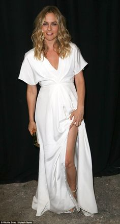White hot! Clueless star Alicia Silverstone, clearly knew all about keeping it chic with her floor length design featuring a thigh-high slit