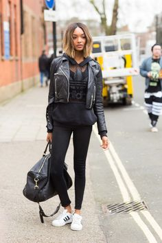 Athleisure Cool Take note from models' off-duty uniform and style a sportier sneaker (like this pair of Adidas Originals) with leggings, a leather moto jacket and loose sweatshirt.