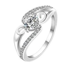 - Material: Sterling Silver - Stones: Solitaire CZ Stone w/ Clear CZ Stones - Face Height: 7 mm - Band Width: 2 mm - Size (Varies)