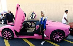 Nicki Minaj rides her 2014 Lamborghini Aventador Roadster after launching her fashion line at Kmart in Los Angeles, California October 15, 2013.  REUTERS/Kevork Djansezian  (UNITED STATES - Tags: FASHION ENTERTAINMENT BUSINESS)