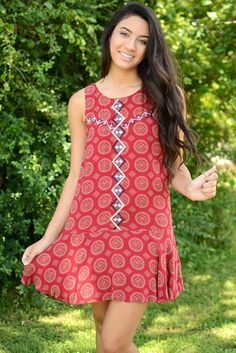 Indie vibes! This gorgeous red swing dress by THML is one a versatile piece every girl needs in her closet. The beautiful gold medallion print adorned throughout the entire piece is definitely eye cat