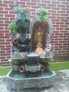 Cuadro con reciclaje de hojas ramas semillas y flores for Bombas de agua para cascadas artificiales