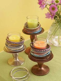 Bracelet Wrapped Votive Holders  Add sparkle to glass votive holders by stacking bracelets on footed candleholders. Vary the colors and styles of the bracelets for an eclectic look. For safety, use only votive candles in glass holders.